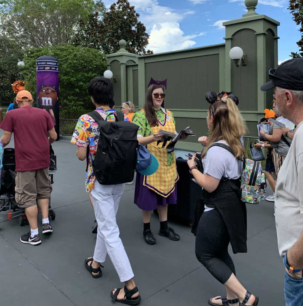Cast members hand out treat bags at MNSSHP at the Magic Kingdom