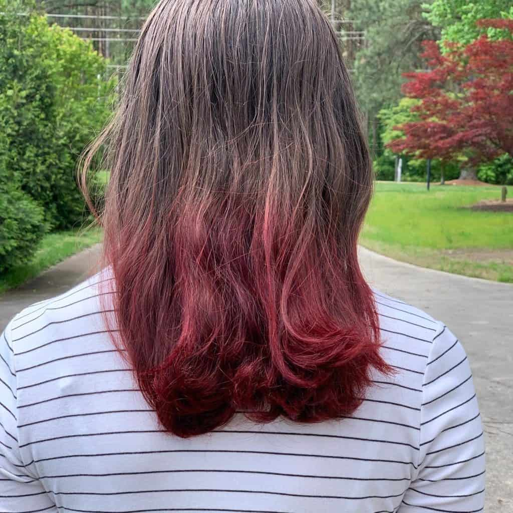 The results of Kool Aid Hair Dye on the ends of brown hair.