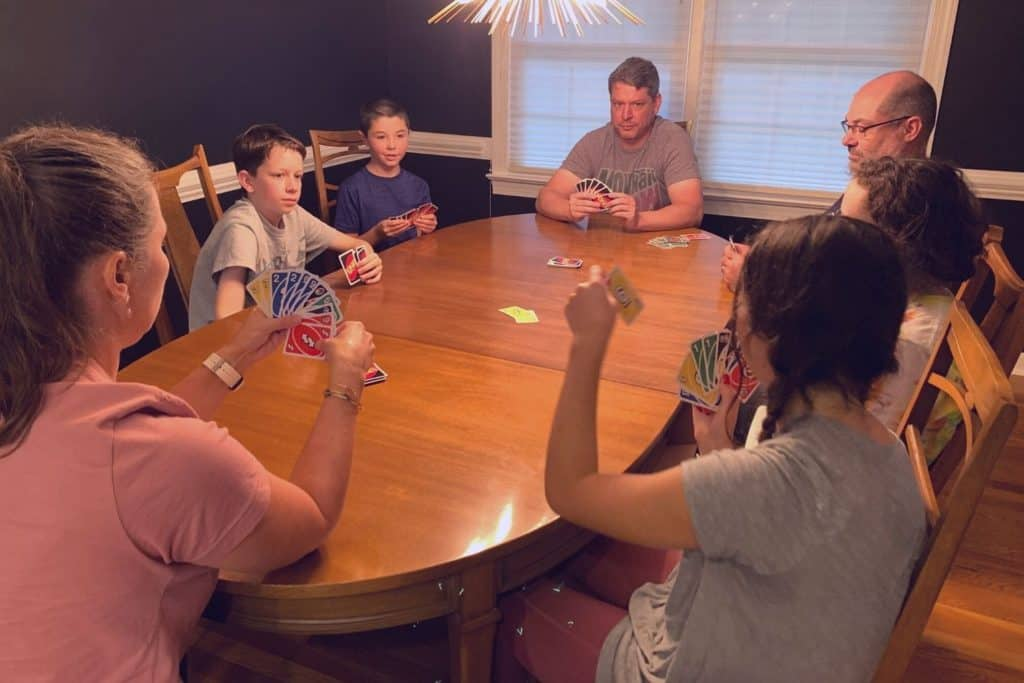 families playing Uno House Rules