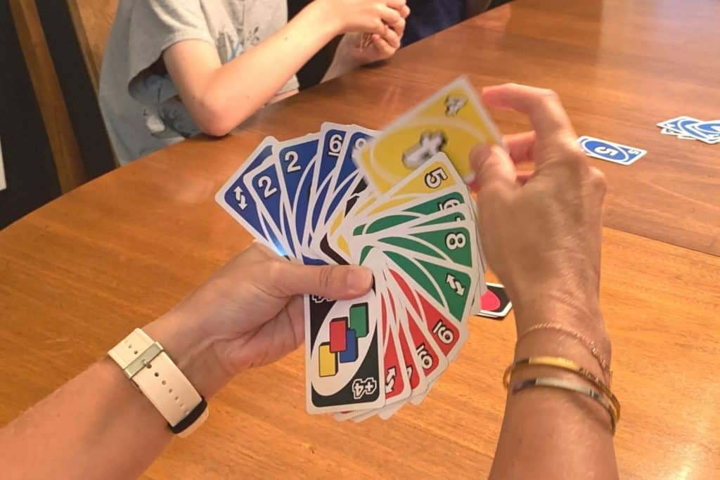 one large hand of cards in Uno House Rules