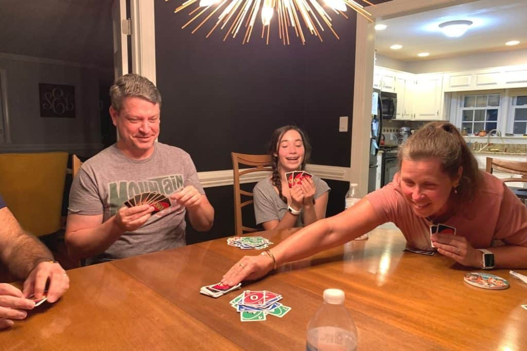 player reaching for more cards in Uno House Rules
