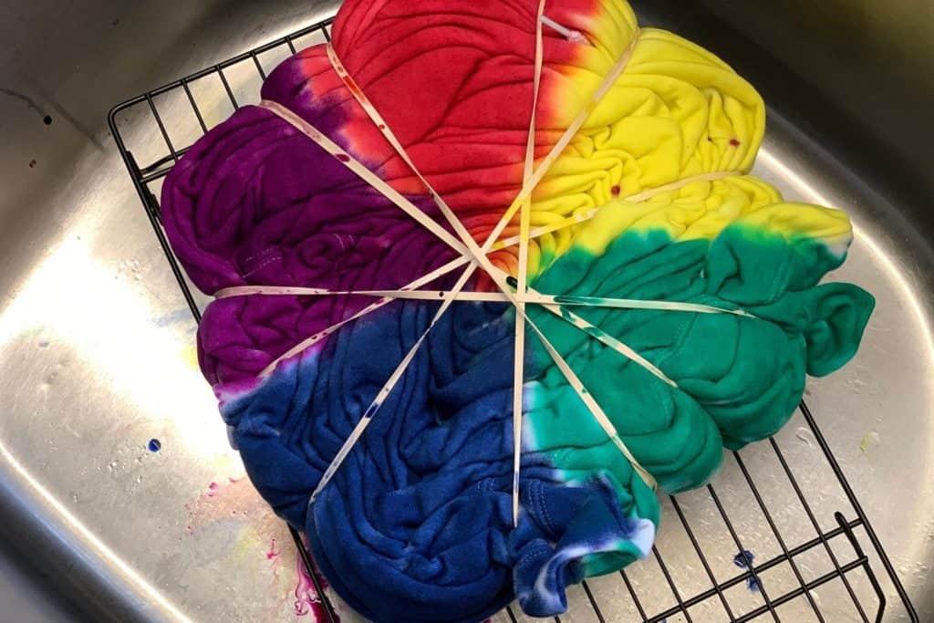 tie dye hoodie in the process of applying color