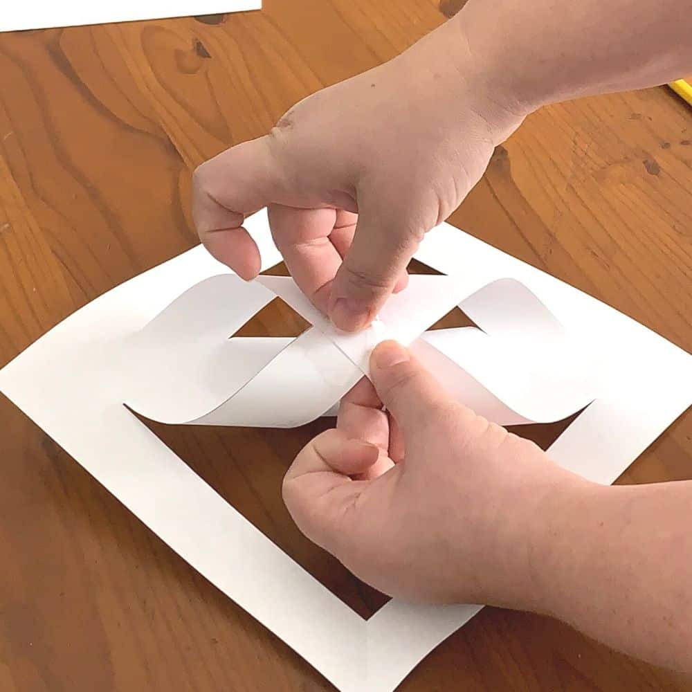 folding the second layer of paper for a giant 3d snowflake