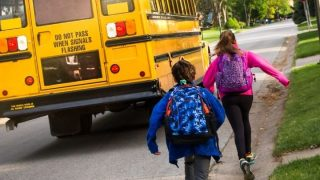 Kids headed to the bus for year round school