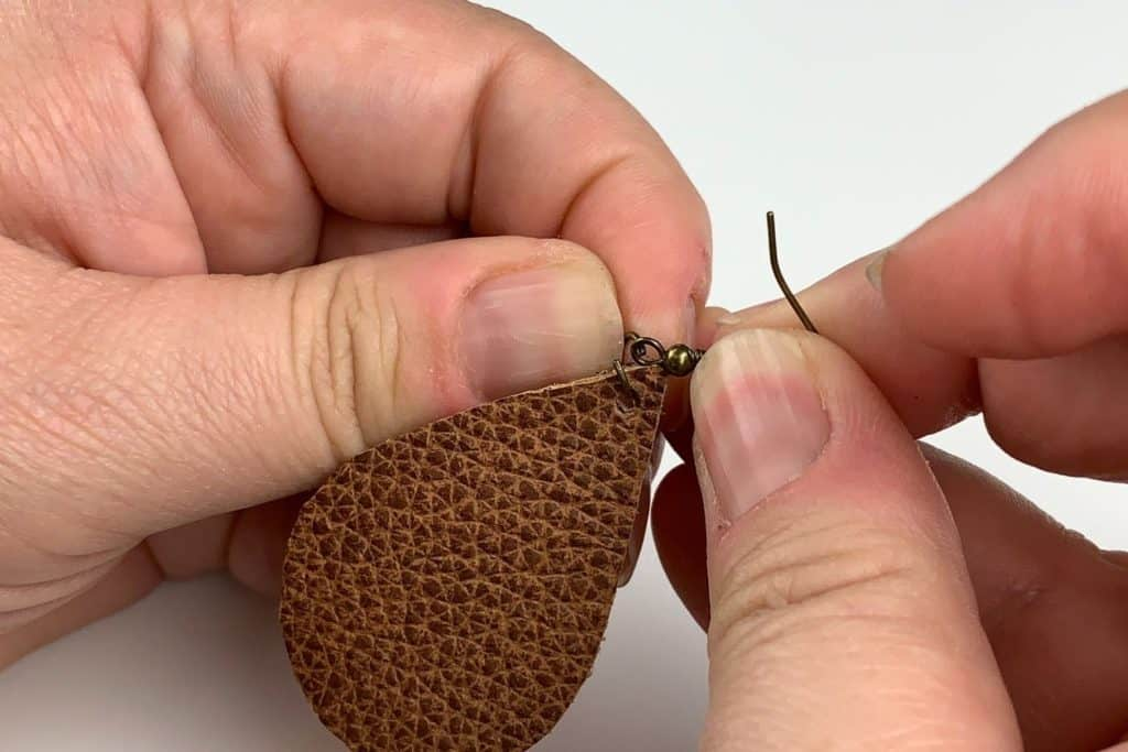 Attaching a jump ring to the earrings