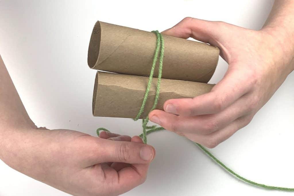 Wrap the yarn around the cardboard tubes