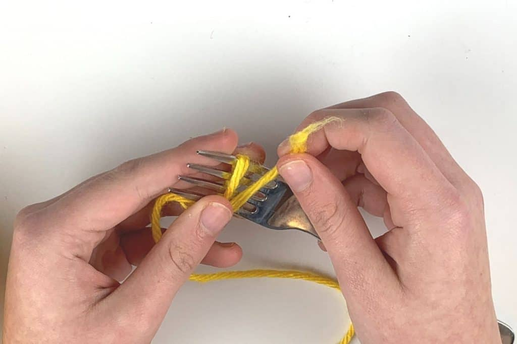 Wrapping the yarn around the fork