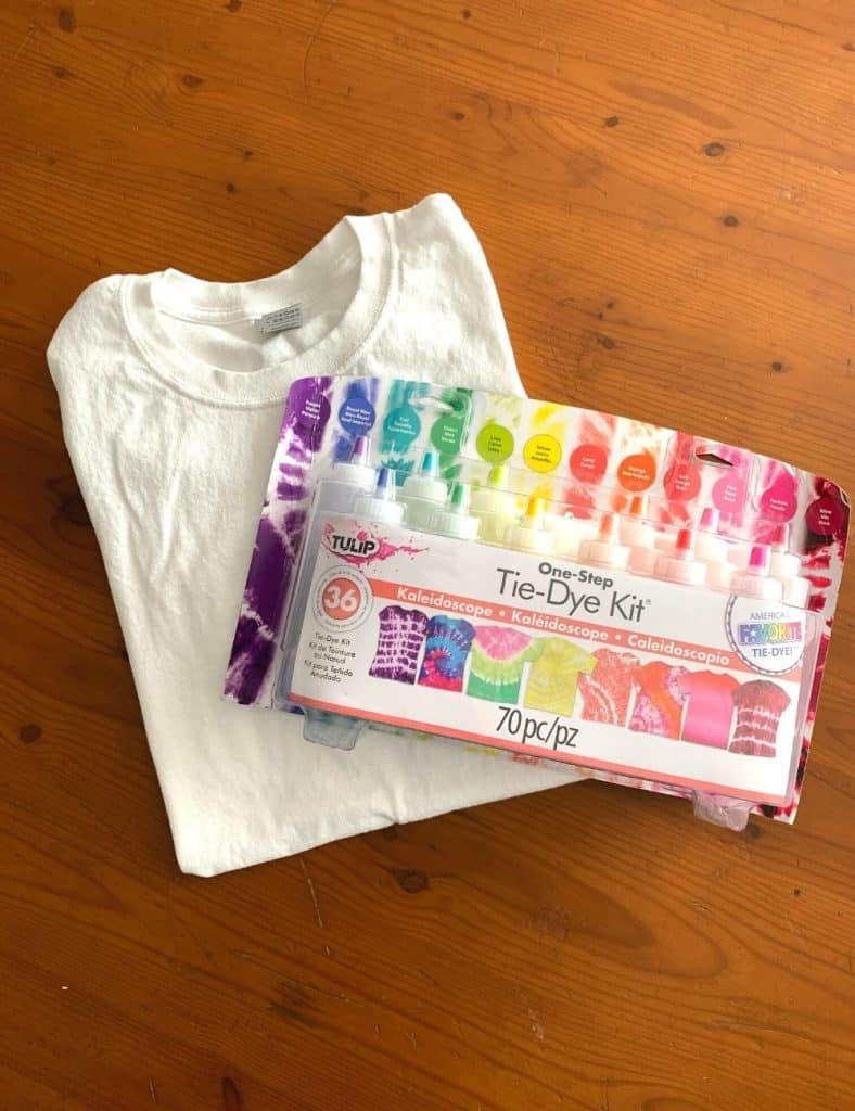 Supplies for tie dye bullseye project: a white t-shirt and a tie dye kit