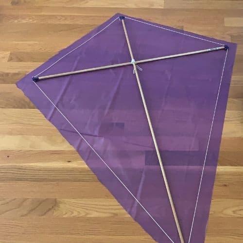 Kite frame laying on a newly cut kite sail