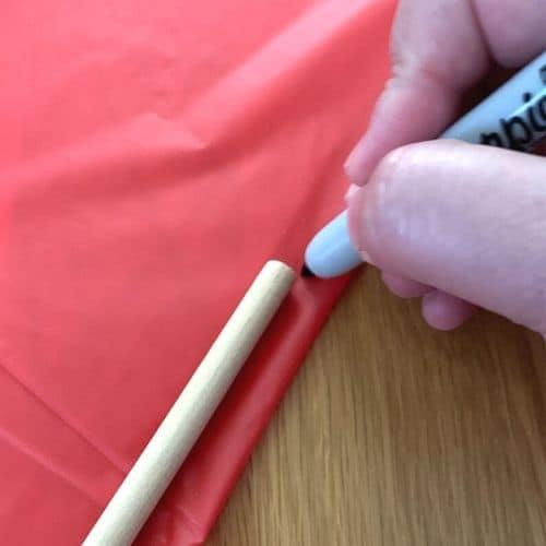Marking the spot to cut a kite sail
