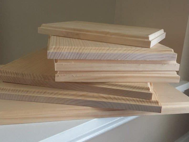 a stack of wooden boards for state string art