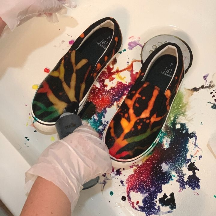 Applying dye to the shoes